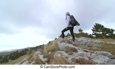 Day hiking woman on top of mountain plateau Ai-Petri crane...