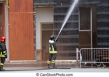 Firefighters extinguished the fire in the building during...
