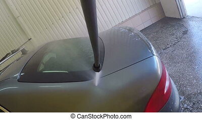 High pressure washer machine washes car clean in garage or...