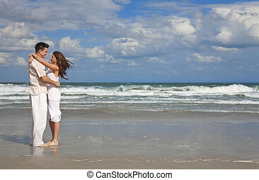 Man and Woman Couple Having In Romantic Embrace On Beach