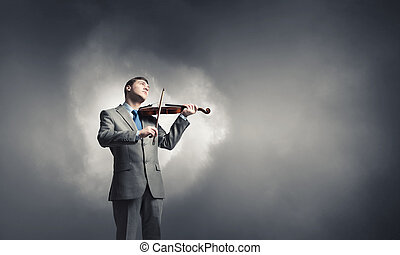 Violin player - Young smiling businessman in suit playing...