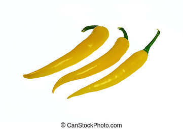 chilis - three yellow chilis on white background