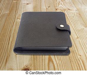 Notebook on the wooden floor