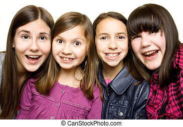 Four happy and smiling young girls