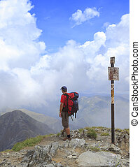 Hiker - Man scrutinizing the horizon in mountains