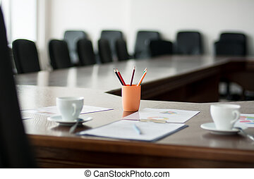 Close-up meeting room with a large table