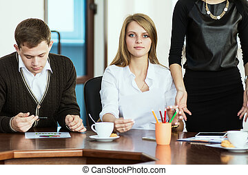 A group of young economists in the office to discuss the...