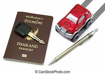 Thailand passport, key, pen and red 4wd car for travel...