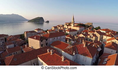 Flying above the old town of Budva, Montenegro - aerial...