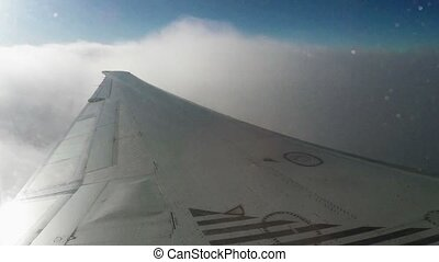 Flying plane - The view from an airplane window - Wing of an...
