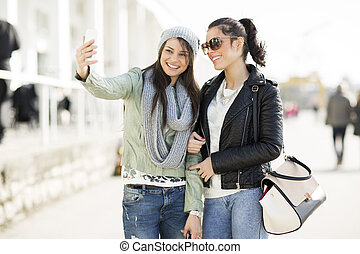 Young women takin selfie outdoor