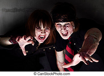 Bloody Zombies - Male and female bloody zombies reaching out