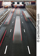 Busy Motorway - Busy traffic on a motorway with a...