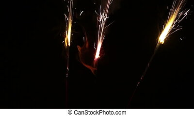Three Sparklers Burning Together Ag - Three Sparklers...