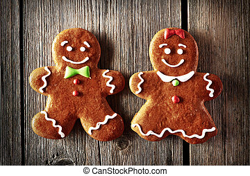 Christmas homemade gingerbread couple cookies on wooden...