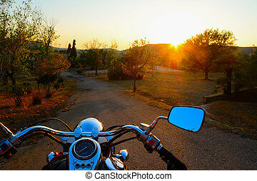 motorcycle on the edge of the road at sunset - classic...