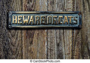 Beware Of Cats Sign On Wooden Door