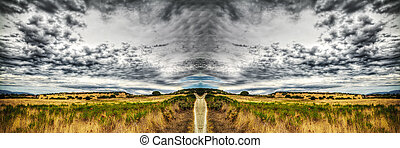 country road under a dramatic sky