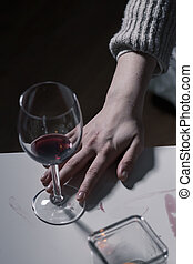 Empty glass of wine standing on table