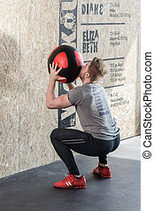 Man training with exercise ball