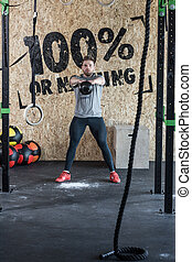 Man during intensive crossfit workout