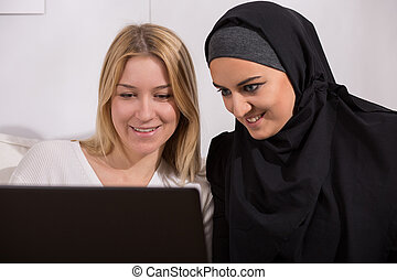 Arabic and european women watching - Photo of arabic and...