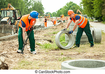 Builders working hard - Photo of two builders working hard...