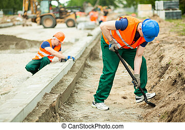 Two builders working - Horizontal image of two builders...