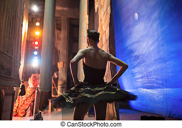 Prima ballerina standing backstage before going on stage for...