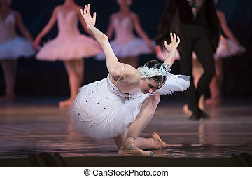 Prima ballerina white swan on stage bow and curtsey to the...