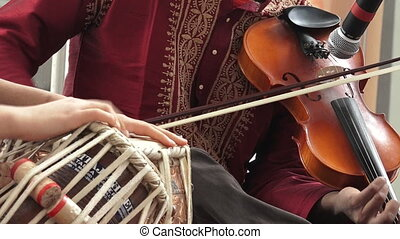 Indian people play music with musical instrument Violin and...