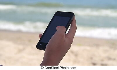 Smart Phone Using on Sea Background