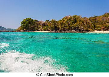 vibrant tropical sea - a tropical island in Thailand vith a...