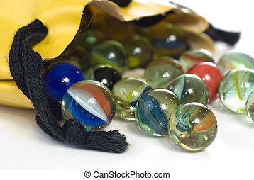 Bag of Marbles - Closeup view of a bag of marbles, shot...