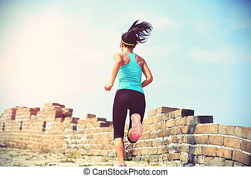 Runner athlete running on chinese great wall woman fitness...