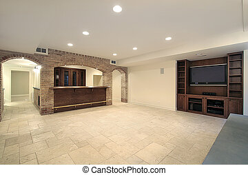 Basement with bar - Basement in new construction home with...