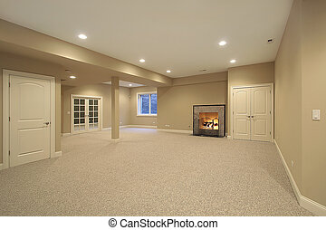 Basement in new construction home with fireplace