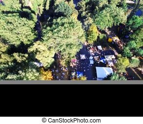 Air shot of a copter, the festival in the park