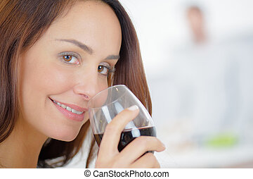 Having a glass of wine at home