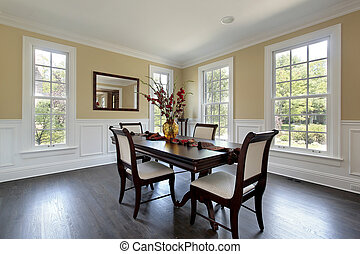 Dining room in new construction home with mirror