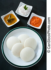 Indian idly with chutney and sambar - A traditional south...