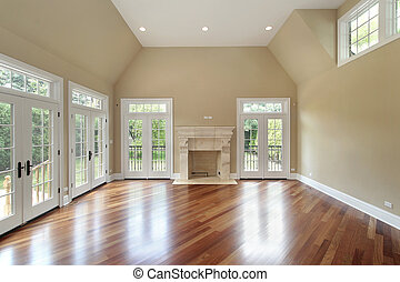 Family room in new construction home with doors to patio