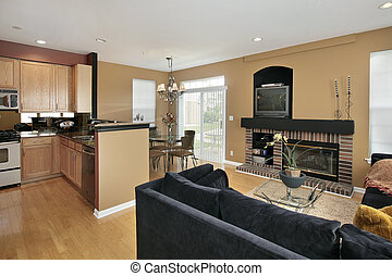 Family room in suburban home with brick fireplace