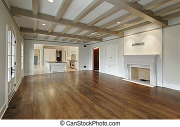 Family room in new construction home with wood ceilings