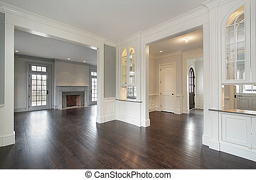 Family room and foyer in new construction plan