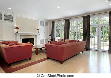 Family room with wall of windows - Family room in suburban...