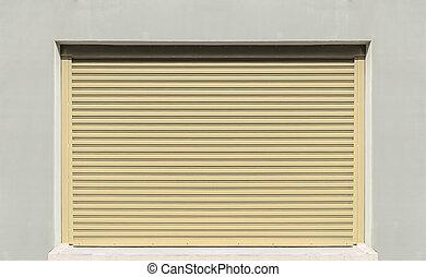 Shutter door or rolling door, beige color.