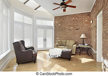 Sun room with brick wall - Sun room with windows and brick...