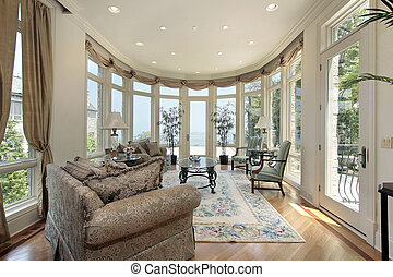Family room with lake view - Family room in modern home with...