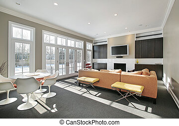 Family room with wall of windows - Family room in luxury...
